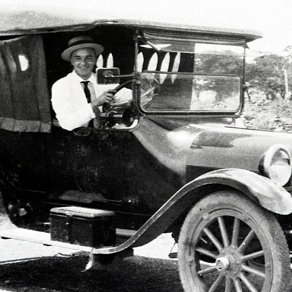 Our Story vintage portrait 4 of Master Distiller Peter Westfall in a car
